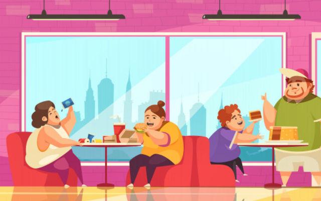 Молодые люди объедаются за столиками в кафе